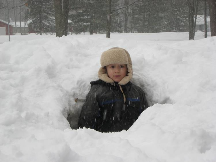 Josiah sticking up out of the snow tunnel