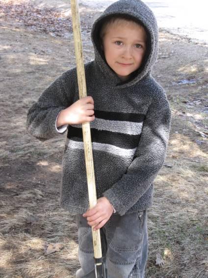 Josiah helping with the raking