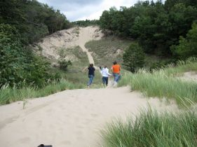 Kevin M., Kristi and Taylor runing up the dune