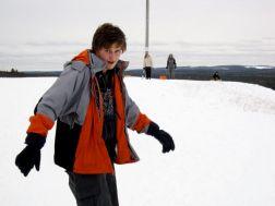 Taylor snowboarding toward me