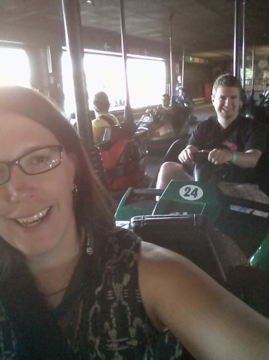My coworker Alex behind me waiting to give me more bumper car related whiplash.
