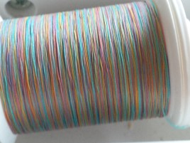 Using a nifty multicolored thread I acquired some time ago waiting for the right project to show off its surprises.