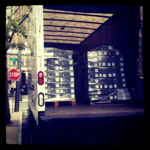 A photograph of collections material on a truck to the Library Shelving Facility on Wall Street, New Haven