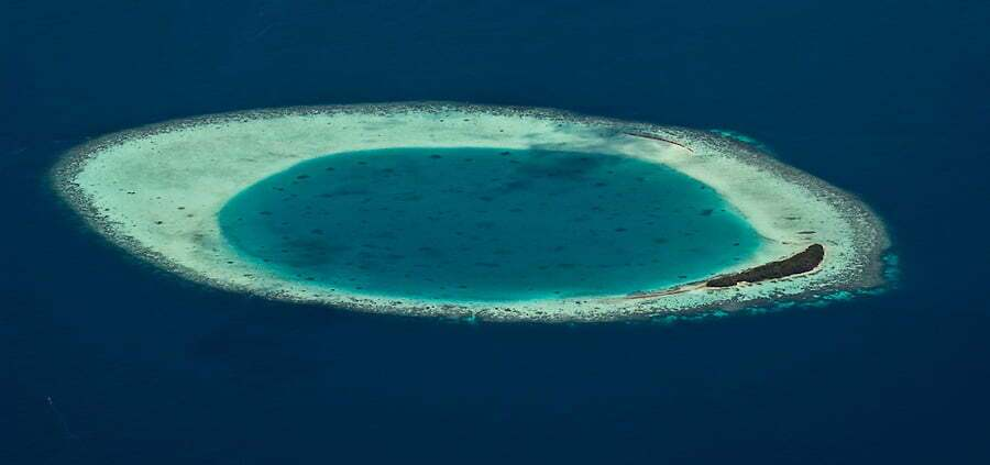 Aerial view of coral reef and atoll edge, Vaavu Atoll, Maldives on 9 October 2007. The Maldives is made up of 1200 islands with an average height above sea level of 1.2 metres. The 200 locally populated islands and 90 resort islands are threatened by global warming and rising sea levels.