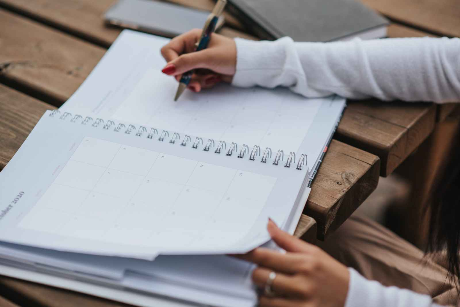 crop woman making schedule in planner