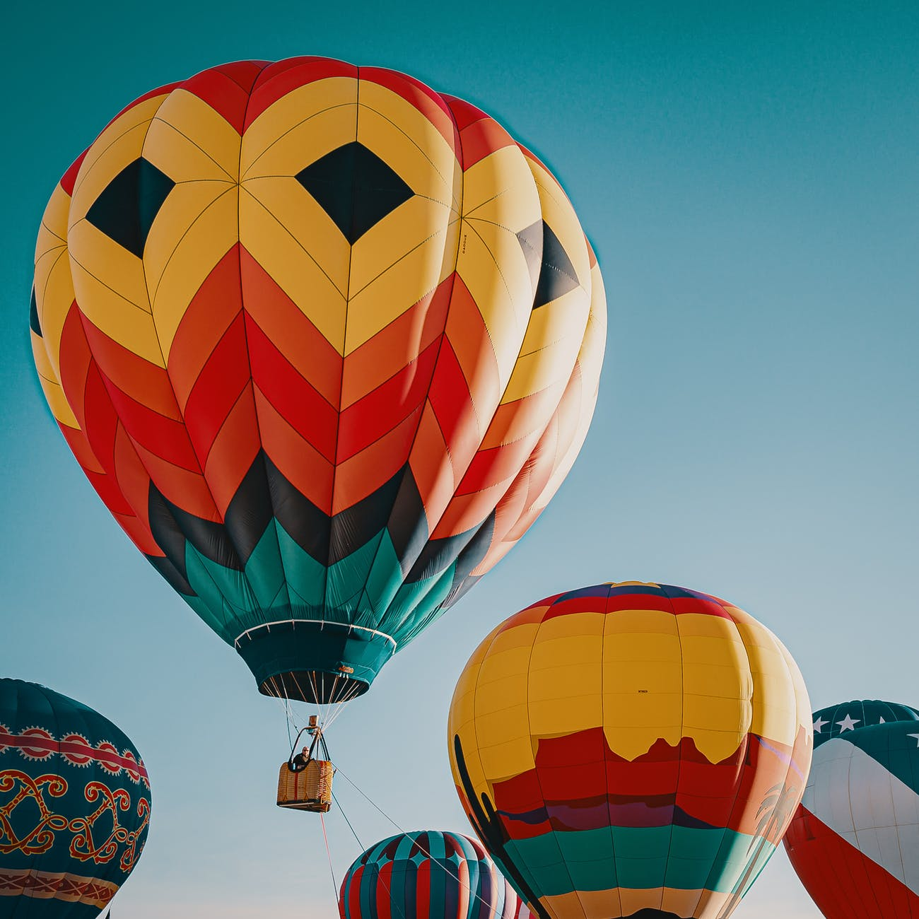 photo of multi coloured hot air balloons