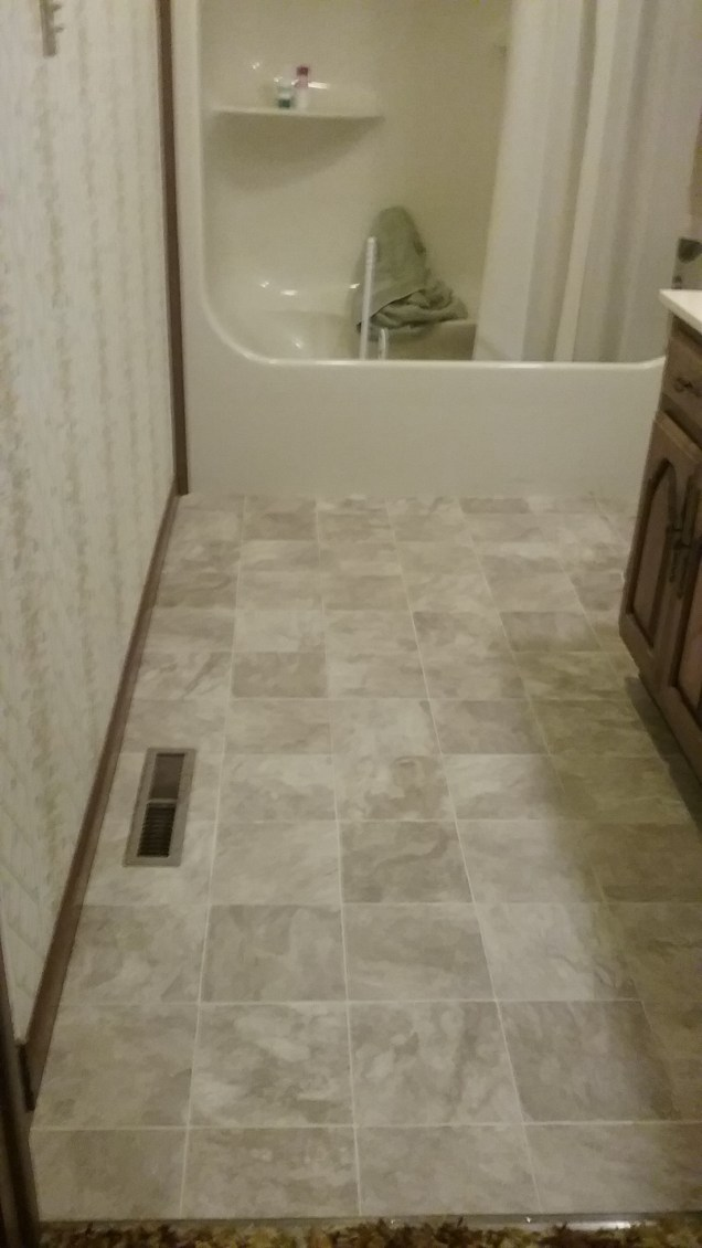 The end product! Beautiful vinyl flooring installed beautifully!