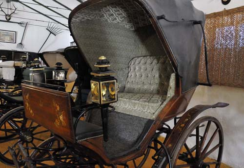 one of the old carriages in the Terry family's collection -- this one has flower decorations painted on the woodwork