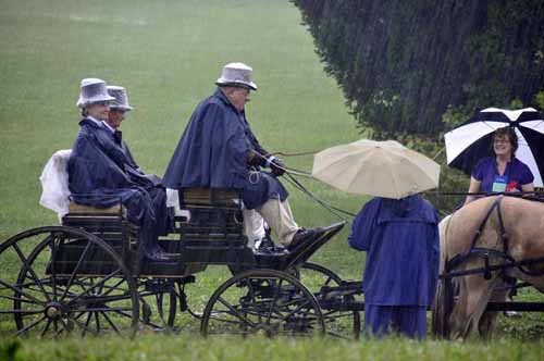 Did we tell you that we had some rain?? Ted Swendson had brought his ponies and carriage all the way from Alberta, Canada, and he wasn't about to let a little rain stop him from the drive on Saturday morning