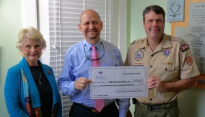 CAPTION: (LEFT to RIGHT) Linda Hilts, Executive Director of Park Place Outreach; Jack Levine, Board President of Park Place Outreach; Tom Cardiff, Scout Executive of Coastal Georgia Council.