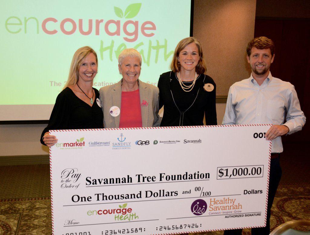 Enmarket presents Savannah Tree Foundation 1000 check at Encourage Health Series