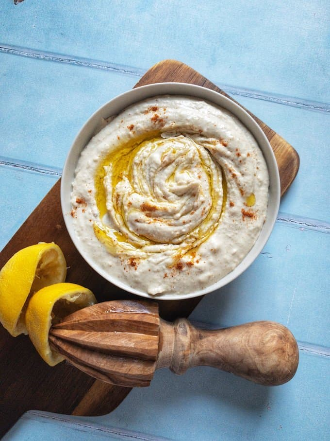 White Bean Hummus - My take on a classic hummus with white beans replacing the chickpeas for a lush and creamy dip. Perfect spread on toast or served with veggie crudités for dipping.