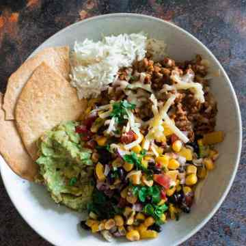 Beef Burrito Bowls with Corn & Black Bean Salsa - All the deliciousness of a classic beef burrito, but lightened up with a fresh and zingy corn and black bean salsa. A great weeknight meal with minimal cooking. Makes excellent leftovers too!