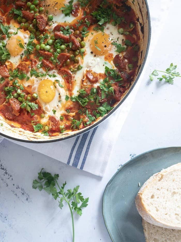 Spanish inspired baked eggs with chorizo, peppers and peas - an easy one-pan brunch dish that's perfect for entertaining.
