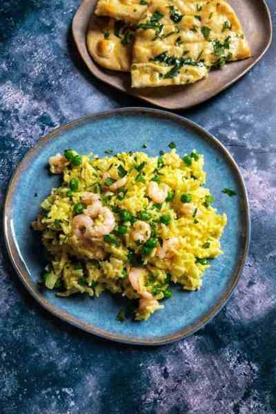 Prawn & Cardamom Rice with Peas - A comforting and mildly spiced dinner of rice baked with cardamom, turmeric and chicken stock with prawns and peas. Easily comes together with some freezer and pantry staples.