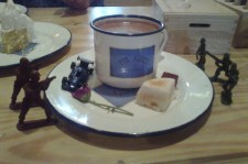 Dark Hot Chocolate served with a homemade marshmallow, dark chocolate ganache dusted with cocoa and plenty of toys!