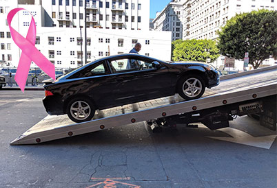 donate car being loaded onto a truck