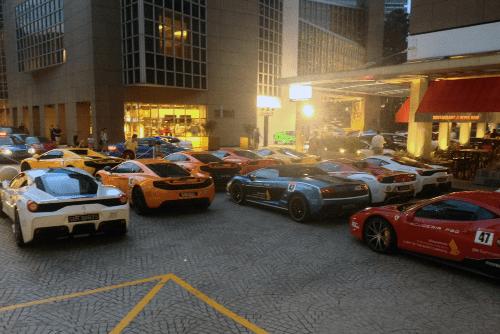 McLaren MP4, Lamborghini Gallardo, Ferrari 458 Italia. Singapore street scene