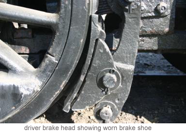 Driver brake head showing worn brake shoe