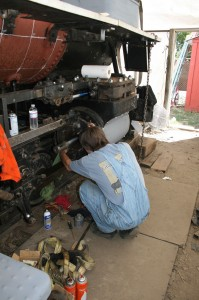 Scott installing the new piston packing.