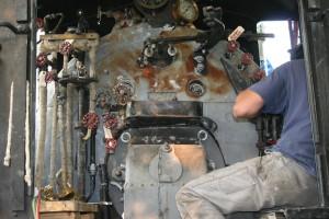 Travis works on fitting up brake plumbing.