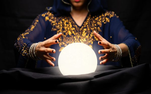 Fortune teller's hands with crystal ball