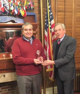 Photo of Nik Kowsar accepting Atena Farghadani's award from Population Institute president, Robert Walker