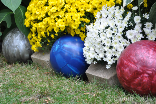 Garden edging with old bowling balls