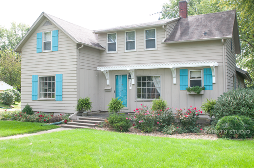 Blue Shutters on gray house with white trim