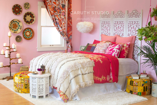 boho bedroom fully dressed with worldly decorating accents