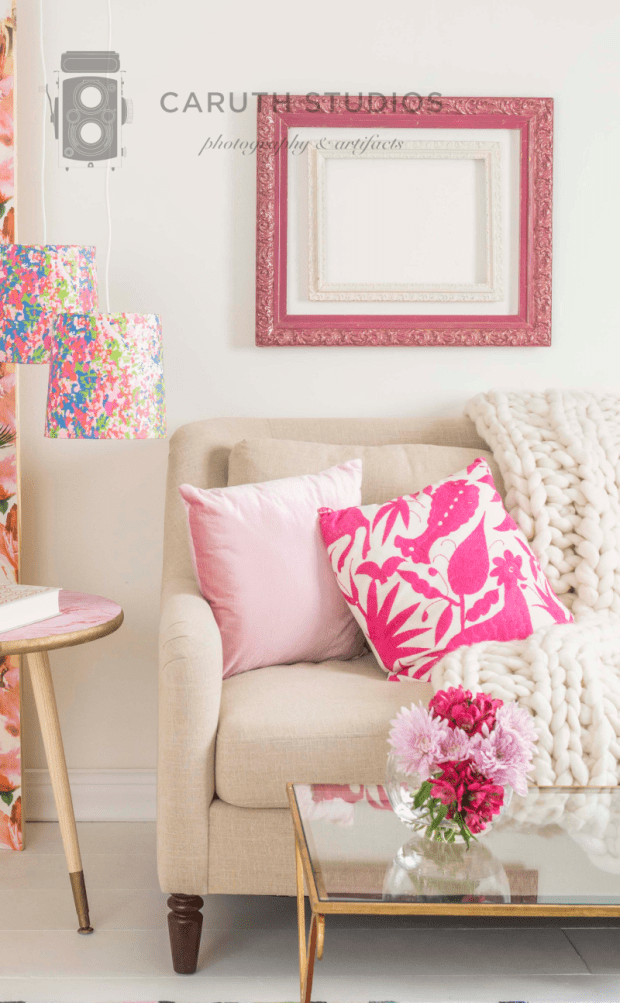 Pink accents in white room