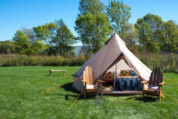 Glamping tent in grassy field