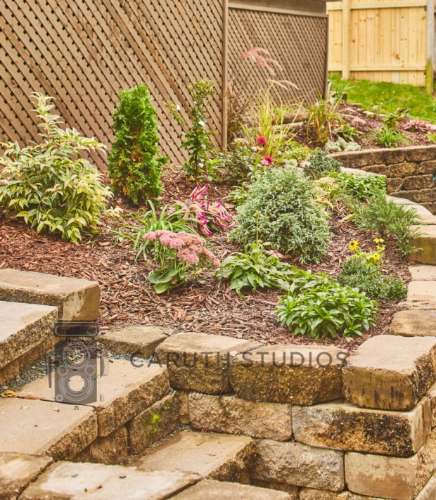 landscaped and mulched retaining wall and steps
