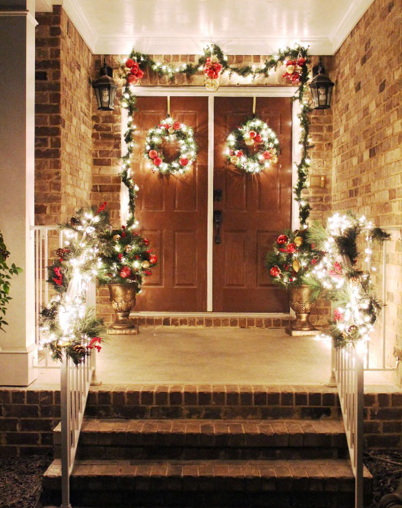 lite wreath and garlands on a night front porch
