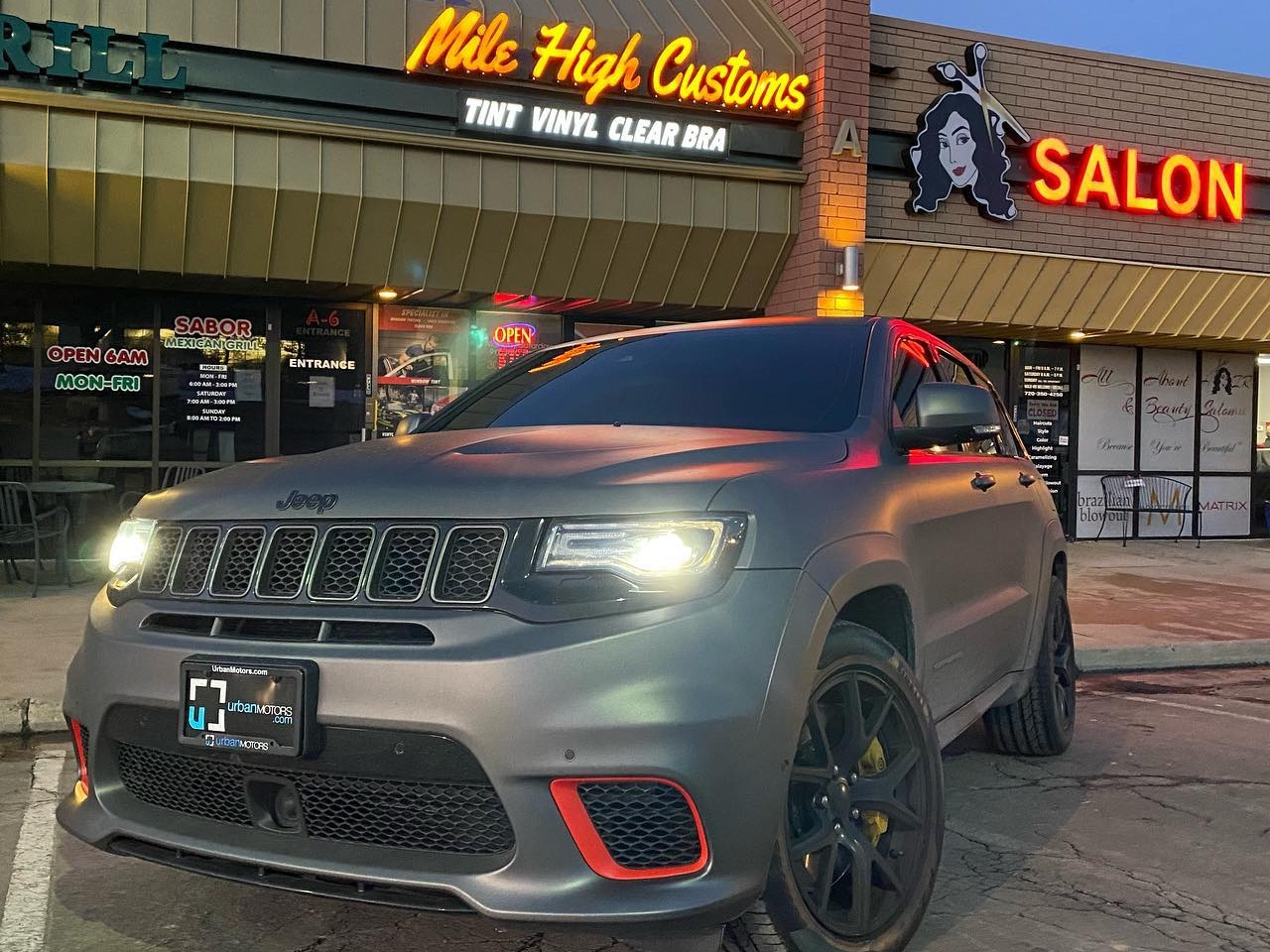Jeep Trackhawk outside Mile High Customs after window tinting job