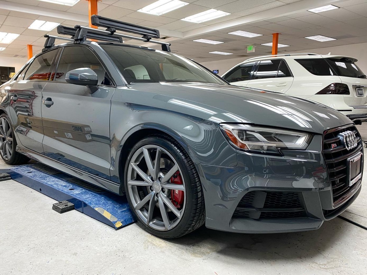 Audi S3 tinted window front side view