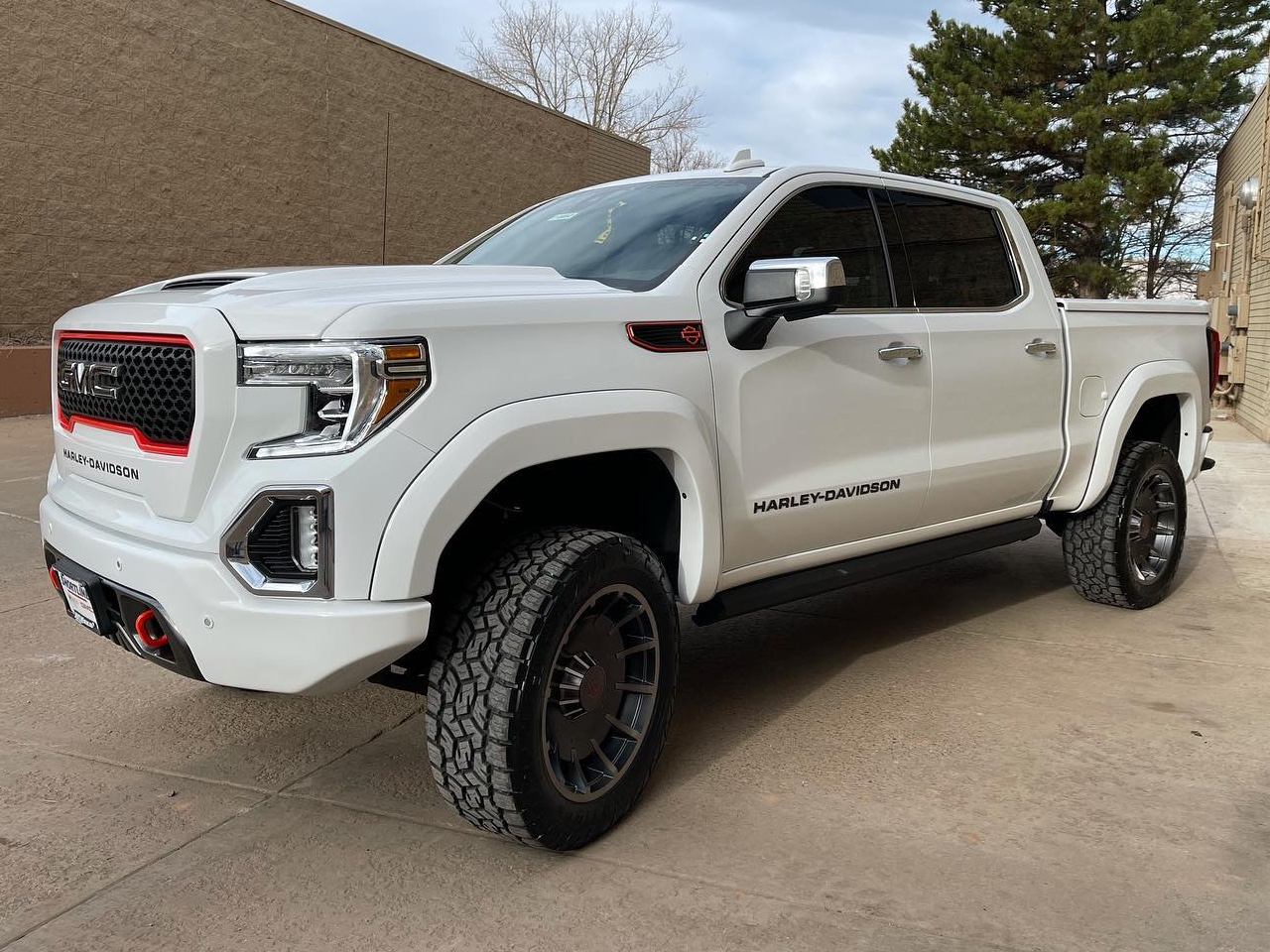 white GMC Harley Davidson tinted windows truck front side view