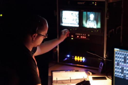 A Stage Manager works in the Control Booth during a production