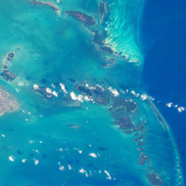 Belize City and reefs ISS-JeffWilliams (05-07-16)