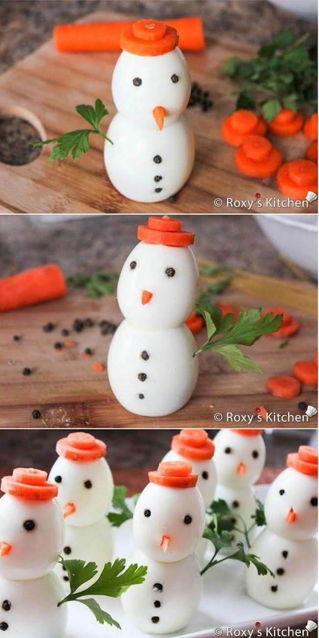 Boneco de neve com ovos e cenouras