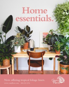 Casa Flora's Home Essentials ad displaying our tropical foliage products around a home office. Call 800-233-3376 to order.