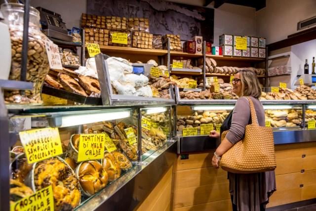 Buying bread at Antico Forno Roscioli bakery in Rome