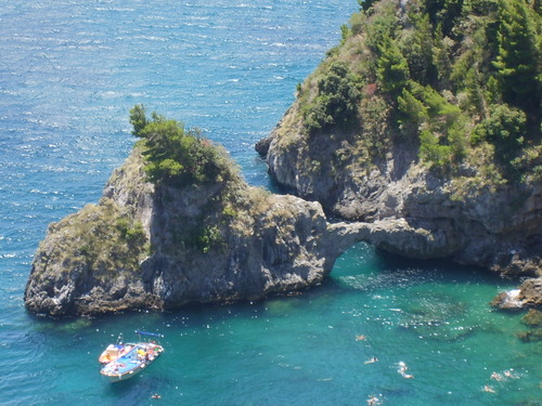 swimming under a natural arch during Amalfi Coast day trips