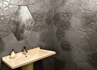 Baño con azulejos de hormigón