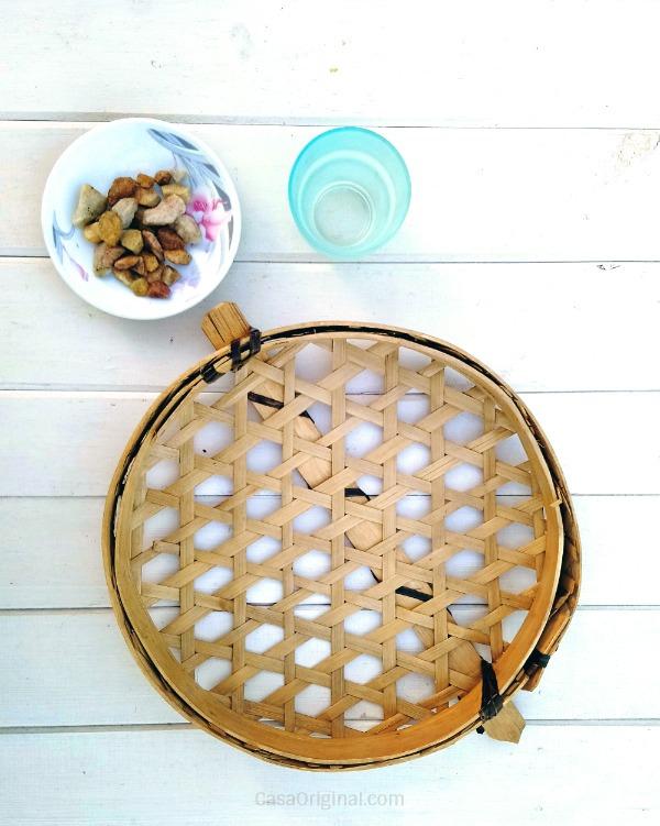 cesta, maceta y piedras
