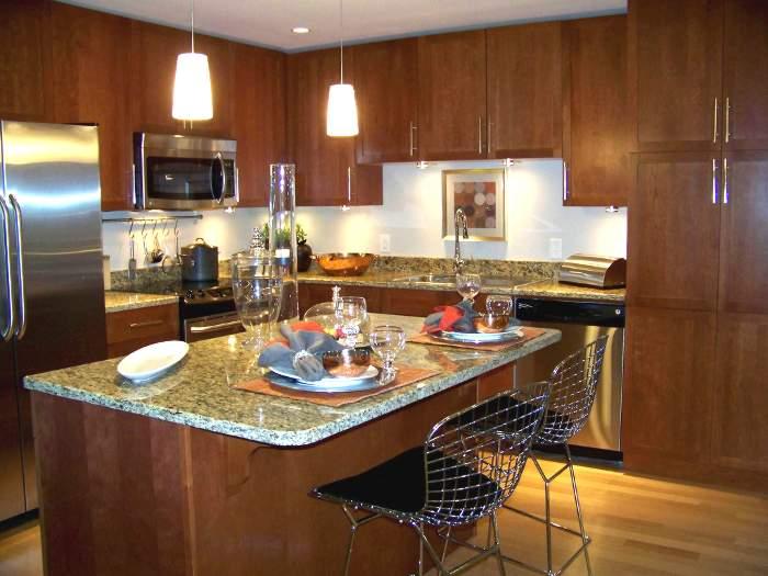 C mo aprovechar una isla o barra de cocina continuaci n for Cocinas integrales con isla al centro