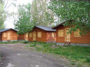 Casas de madera integradas en los bosques de Casas Carbonell