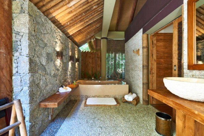 rustic-luxury-bathroom-with-exposed-stone-wall-718x479