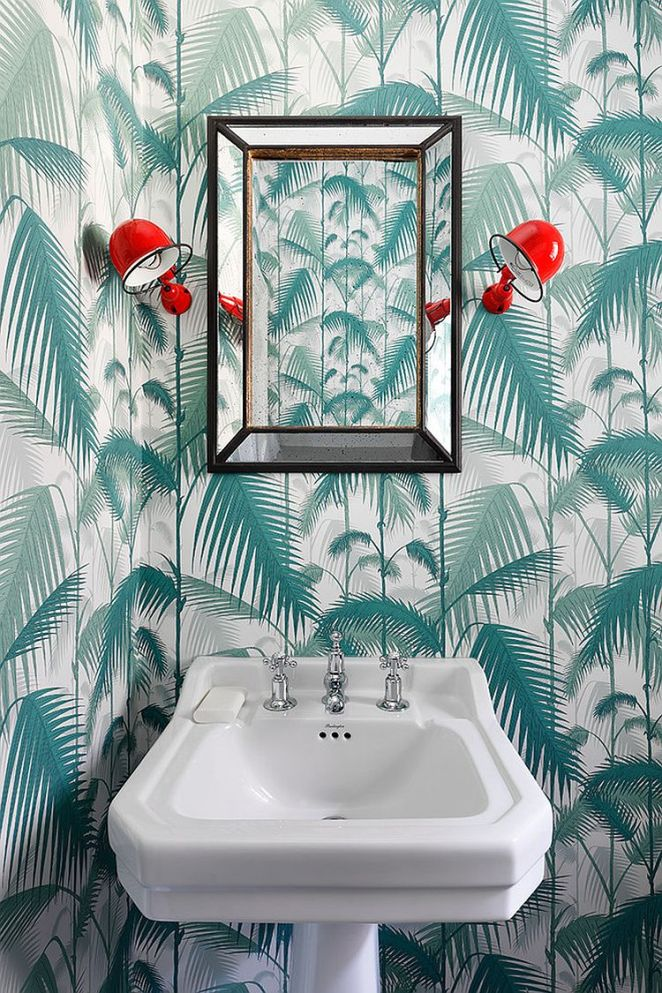 Wall-sconce-add-a-pop-of-red-to-the-delightful-powder-room