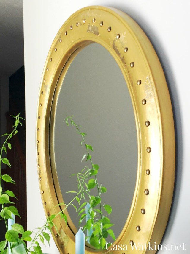 DIY mirror makeover with tacks and gold leaf
